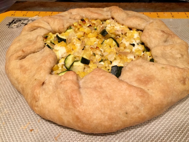 Fresh corn galette with goat cheese, zucchini, & thyme...summer recipe perfection, looks fancy but is easy to make